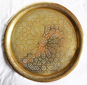 A patterned brass plate